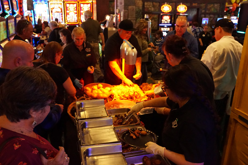 People eating food at Emerald Island Casino's Pig Out 2018