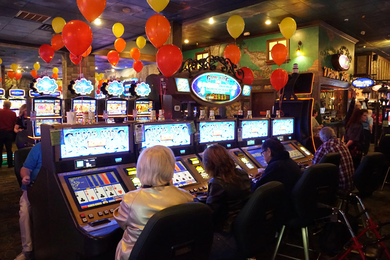 Emerald Island Casino guests using slot machines