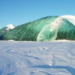 Snow and an Emerald Ice Bergs on a clear day