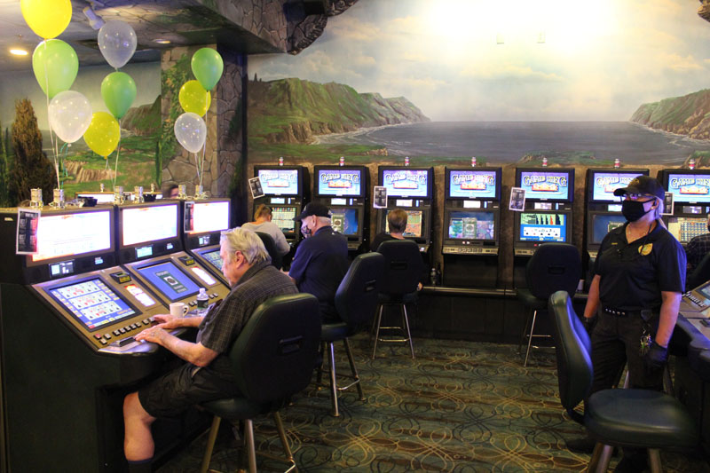 gaming floor with employee wearing mask