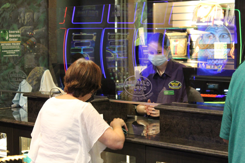 A guest getting a reward at Emerald Island Casino's Rewards Center